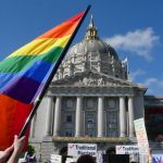 Photo of pro and anti-Proposition 8 protesters rally in front of San Francisco City Hall as California Supreme Court determines definition of marriage