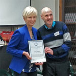 Photo of Lyn White receiving Australian Humanist of the Year 2019 award from Lyndon Storey