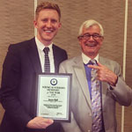 Photo of Jason Ball receiving Young Australian Humanist of the Year 2016 award from Julian Burnside