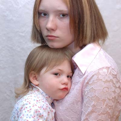 Photo of frowning mother and young daughter