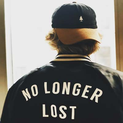 Photo of boy wearing 'NO LONGER LOST' jacket