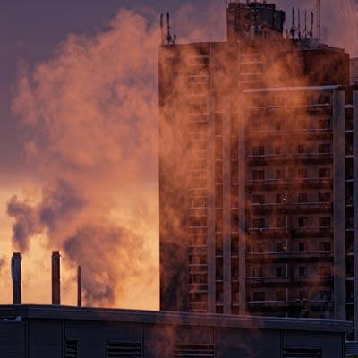 Photo of smoking chimney stacks in London, Canada